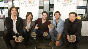 That's the ticket... Powderfinger with the plaque unveiled in their honour at the Sydney Entertainment Centre.