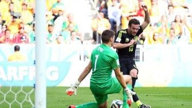Game over: Juan Mata tucks away the third goal.