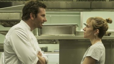 Bradley Cooper and Sienna Miller face-off in the kitchen in <i>Burnt.</i>