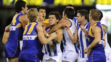 In the thick of it ... tempers spilled over during yesterday's game between North Melbourne and West Coast Eagles...The Kangaroos were a different team from the one that was thumped by St Kilda last weekend.