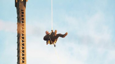 Flying Fox ... Mr Fox abseils off the Harbour Bridge, grinding Sydney transport to a halt.