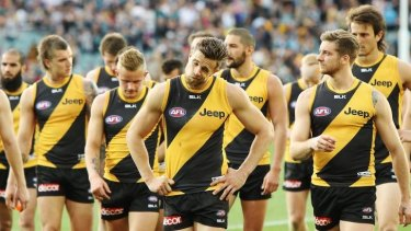 Richmond players leave Adelaide Oval.