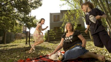 Parthena Xenidis and children Alex and Kristine outside their home in Kensington.
