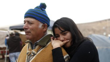 Relatives of a trapped miner, Carlos and Tabita Galleguillos, wait for news from the mine.