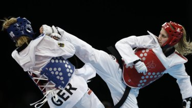 Not to be ... Australia's Carmen Marton (in red) lost her bronze medal match against Germany's Helena Fromm.