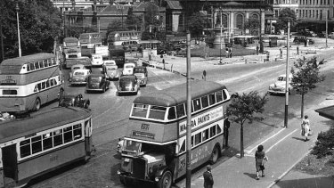 """People enjoyed being upstairs and on a higher level"" ... double-deckers fill the streets around Queens Square when they comprised a large proportion of the city's bus fleet."