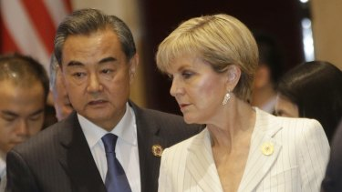 Foreign Affairs Minister Julie Bishop with Chinese Foreign Minister Wang Yi at an ASEAN meeting in July.