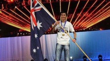 World Cyber Games gold medal winner Charlie Elliott proudly waves the flag.