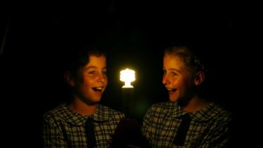 Earth Hour ...  students  Beatrix Hardy and  Scarlett Hardy with an energy efficient light bulb  at Hamilton South Public School in Newcastle.