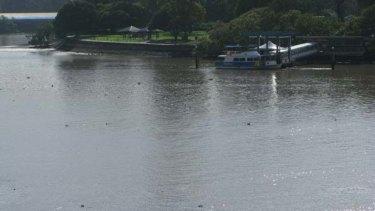 Debris is scattered across the Brisbane River.