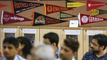 US universities banners are displayed at a session by the University of Southern California Education Foundation in Mumbai, last month. Indian students in the US are often snapped by companies like Google and Microsoft.