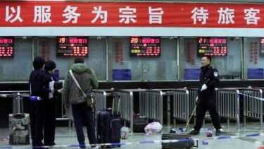 Chinese police investigators inspect the scene of an attack at the railway station in Kunming.