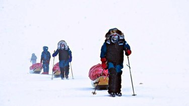 The team of explorers on the approach in white-out conditions.