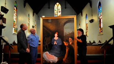 Stephen Holmes, Peter Cook and Artist Walter Magilton with the painting in Christ Church.