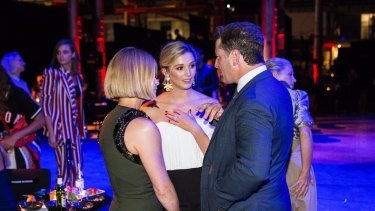 Jasmine Yarbrough shows off her engagement ring to Harper's Bazaar Australia editor Kellie Hush alongside Karl Stefanovic at the David Jones autumn winter collections launch on Wednesday.
