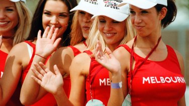 Qantas grid girls wave to the crowds at the 1999 Australian Grand Prix, Melbourne.