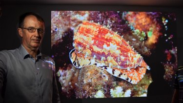 Associate professor Mike Lawrence who is reserching the marine cone snail which uses venom to stun its fish prey.