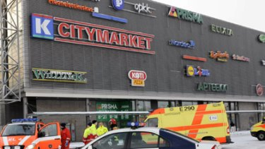 Police vehicles and ambulances are parked outside the Sello shopping centre.