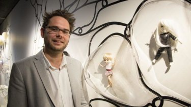 London's Design Museum curator, Alex Newson, with Makie dolls.