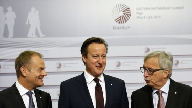 Happier times: British Prime Minister David Cameron flanked by Mr Tusk (left) and Mr Juncker in Latvia last year. Mr Cameron's behaviour has left Mr Juncker angry and bitter.
