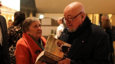 Keneally signs a copy of his book for Margaret Fulton.