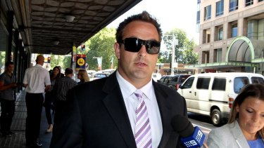 Avoided jail ... former Bulldogs player Ryan Tandy leaves court today.