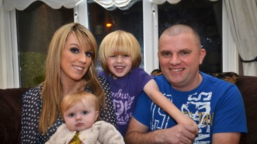 Emma and Eoin Monaghan - with Maleah, 9 months, and Jamie - are left with a house worth $150,000 less than what they paid for it. About 100,000 Irish families are in trouble with the mortgages.