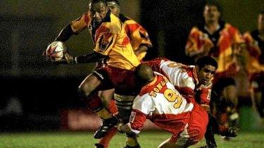 Papua New Guinea take on Tonga at the 2000 tournament.