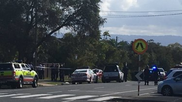 Police investigate a shooting at Labrador, on the Gold Coast.