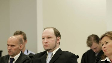 Killer Anders Behring Breivik (right) sit in court with his defence lawyer.