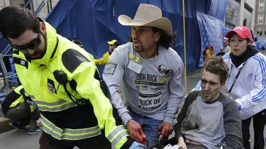 Acted out of instinct: Carlos Arredondo helps Jeff Bauman after the blasts.
