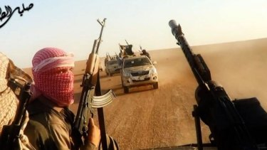 A still from a video showing ISIL fighters near Tikrit.