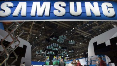 Fighting back ... workers set-up a Samsung booth as they prepare for the 2012 International CES at the Las Vegas Convention Centre.