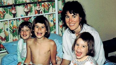 Happy bedtime: Chrissie Foster with Aimee, Emma and Katie before their world was shattered.