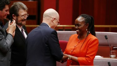 Senator Lucy Gichuhi is congratulated by LDP senator David Leyonhjelm after delivering her maiden speech in the Senate.