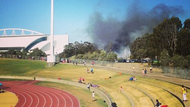 The blaze at Homebush viewed from the athletic track.