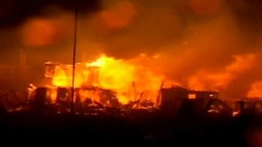 A huge fire erupted as superstorm Sandy ripped through New York City.