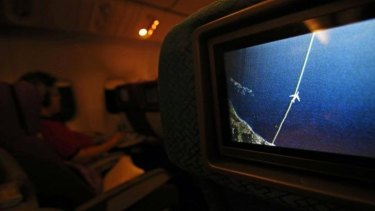 A screen on board a Malaysia Airlines Boeing 777-200ER shows the plane's flight path as it cruises over  the South China Sea from Kuala Lumpur towards Beijing.