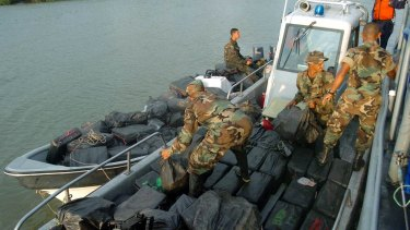 Colombian marines with  a cocaine load confiscated near Tumaco in 2005.