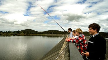 Local boys (from left) Sean Kennedy, Oscar Wiechmann, Brayden Knowles and Billy Jenkin fish at the brimming Sugarloaf Resevoir.