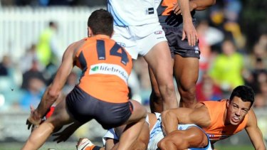 Total eclipse … the Suns' Karmichael Hunt hits the turf.