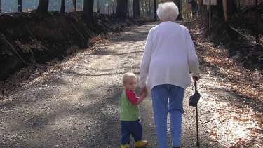 'Road to Recovery', Bonnie Patterson's poignant and powerful photograph of two-year old son Sam walking hand-in-hand with his great-grandmother Freda Fraser, captures 90-year-old Freda's willingness to look ahead, Sam's to look back, and together to move forward on their journey with hope and courage after living through the Black Saturday fires which devastated their hamlet of Castella in 2009.