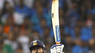 Six and out . . . Mahendra Singh Dhoni hits the winning shot.