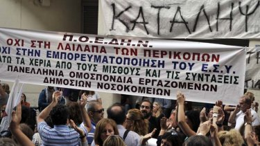 Greek tragedy ... crowds protest against the overrun and under-staffed hospitals in Athens.