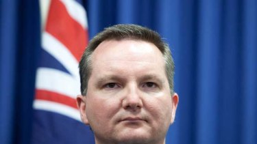 Immigration Minister Chris Bowen: Heckled and chased by protesters.