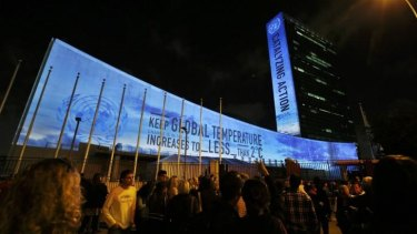 Messages in support of action to combat climate change are projected onto the side of the UN building in New York on September 20, ahead of the international summit on the issue that begins on Tuesday.