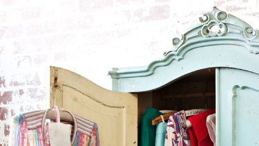 Fashion fix ... use storage boxes to streamline overflowing wardrobes.