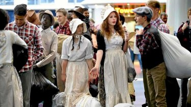 Faithful re-enactment: teenagers in period costume board a train to Ballarat for the 'Mormon migration' pilgrimage.