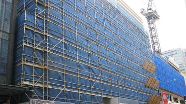 The Elizabeth Street facade covered ready for staged removal.