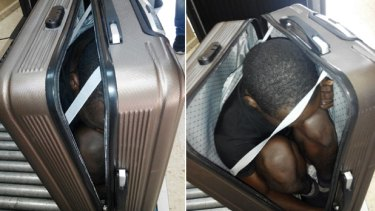 A 19 year-old migrant from Gabon is photographed in a suitcase, in Ceuta, Spain.